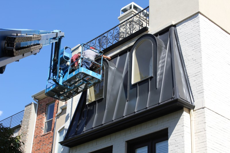 team members installing dormers on a building